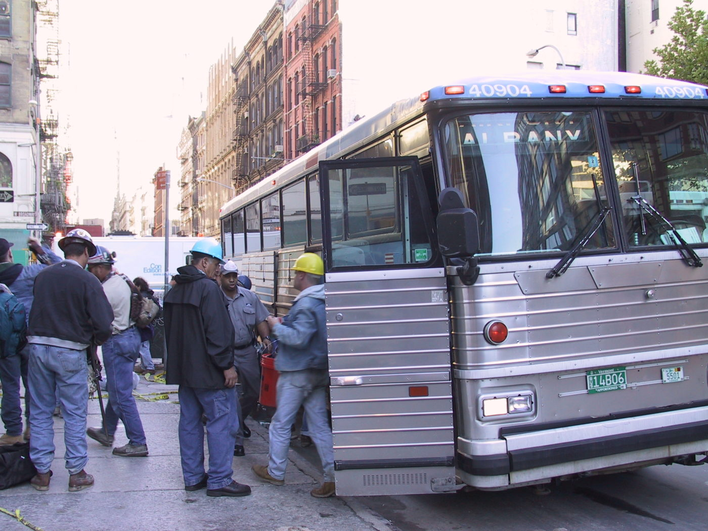 Workers getting off a Bus at West Broadway to Help with Cleanup.JPG