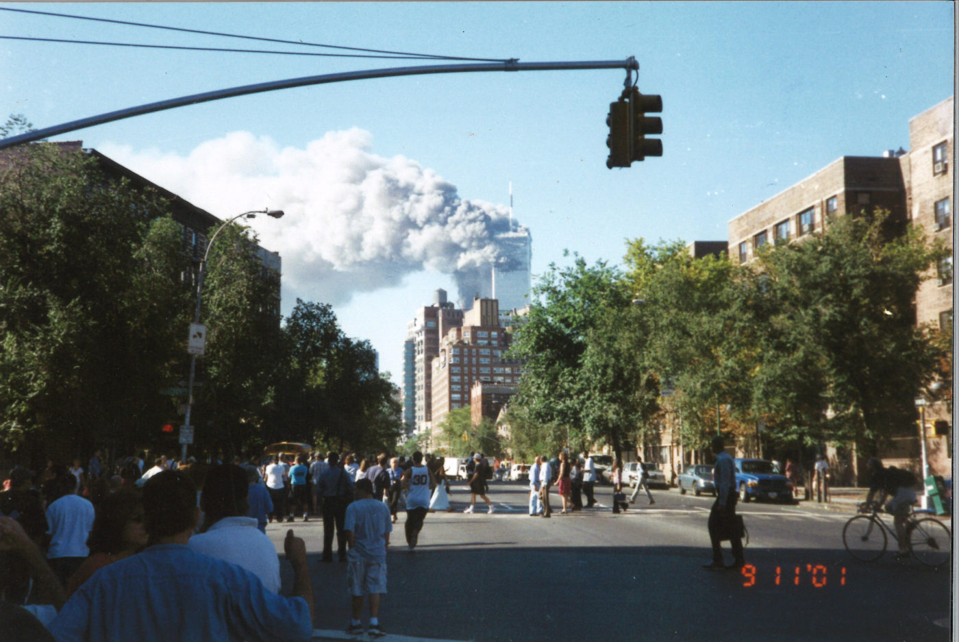 Crowds of New Yorkers Gather to watch the Towers Burning from Bleecker Street and 6th Avenue .jpg