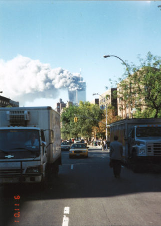 Man Standing in Between Traffic at Bleeker Street and 6th Avenue Watching as the Towers Burning.jpg