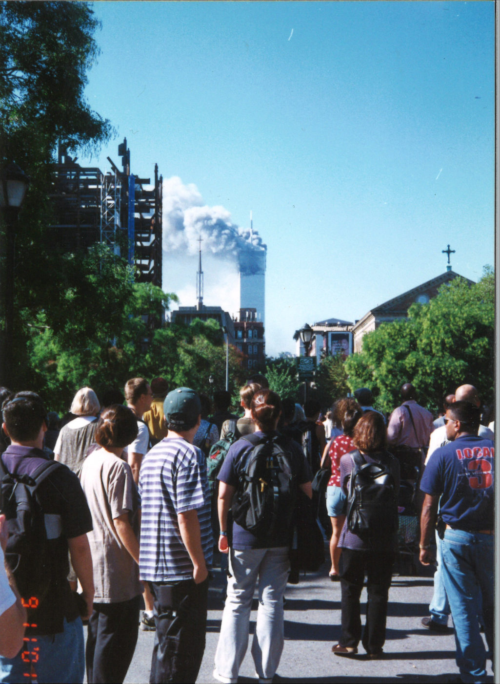 New Yorkers Gather to Watch from Washington Square Park as Tower 1 Burning after Collapse of Tower 2 .jpg