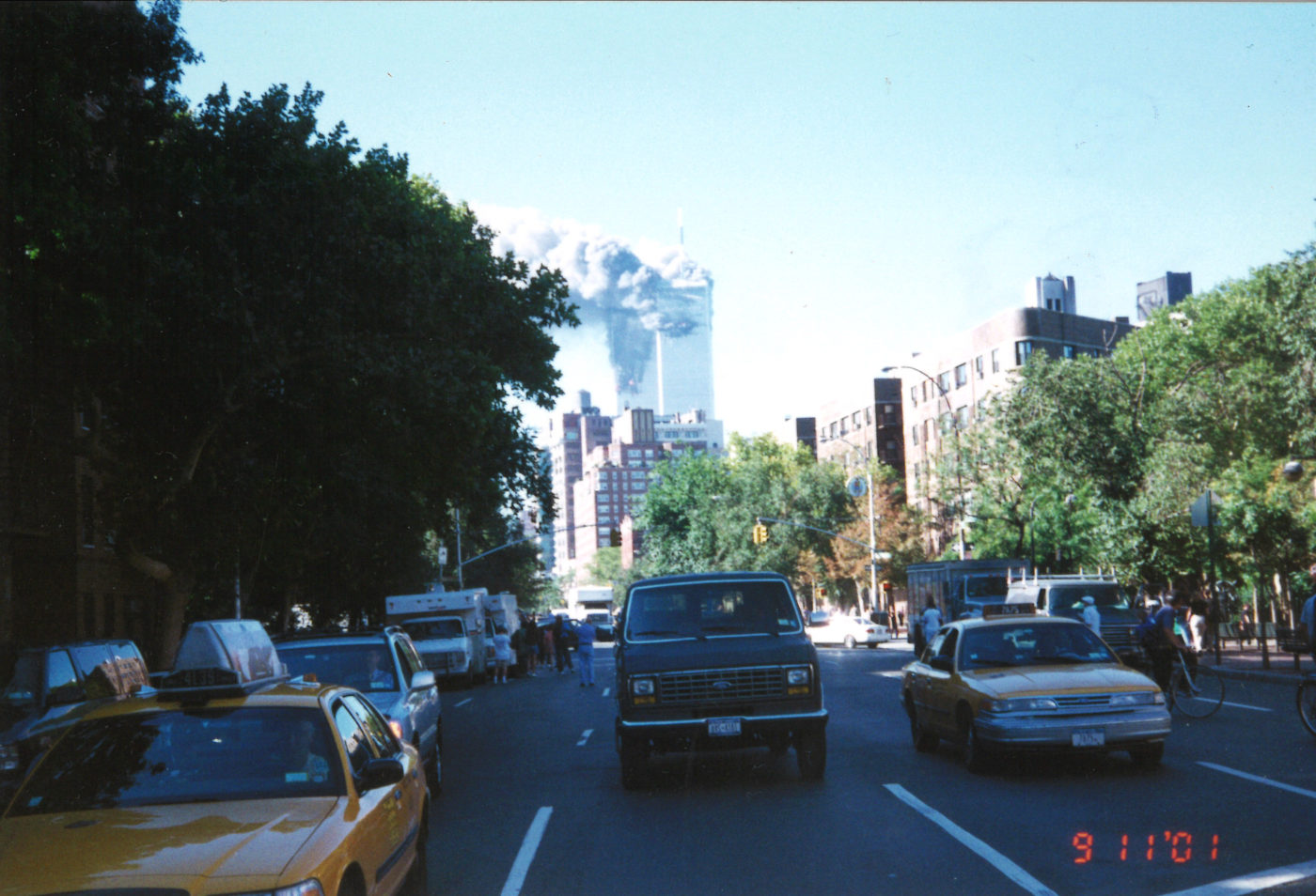 New Yorkers Stand Together at the Corner of Bleecker Street and 6th Avenue as the are Towers Burning.jpg