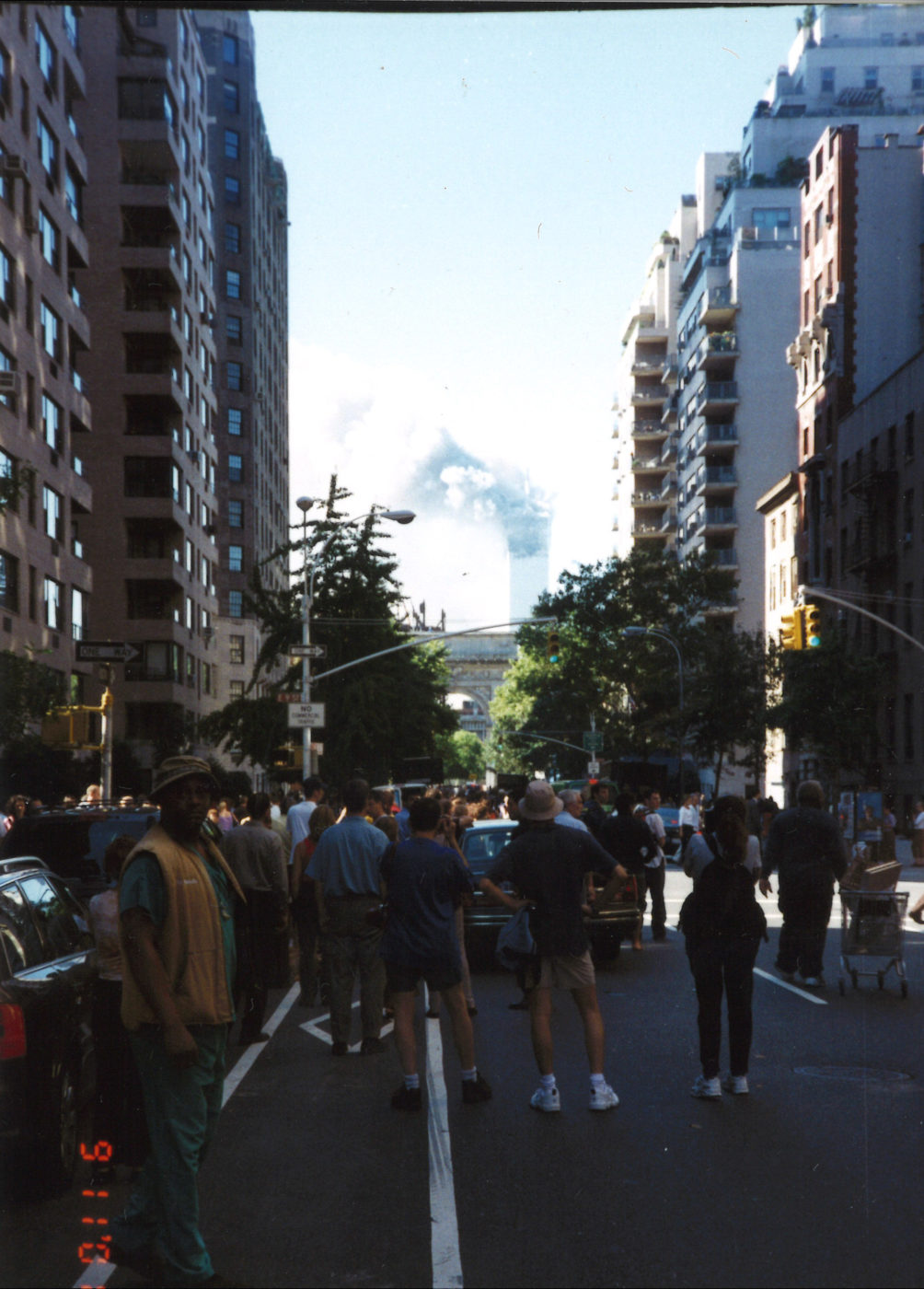 New Yorkers Stand Together Looking South Down 5th Avenue Tower 1 Burning after collapse of Tower 2.jpg
