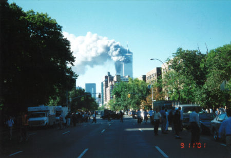 New Yorkers Standin on 6th Avenue Transfixed as Towers Burn.jpg