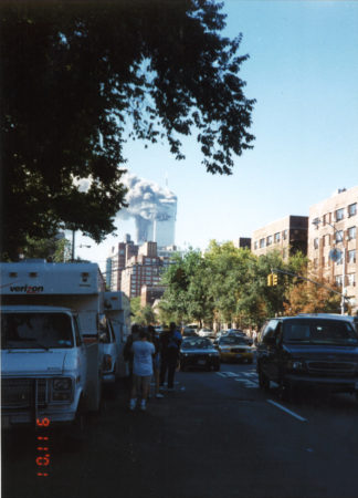 New Yorkers Standing Alongside Wacthing Traffic Towers Burning as seen from Bleecker Street and 6th Avenue.jpg