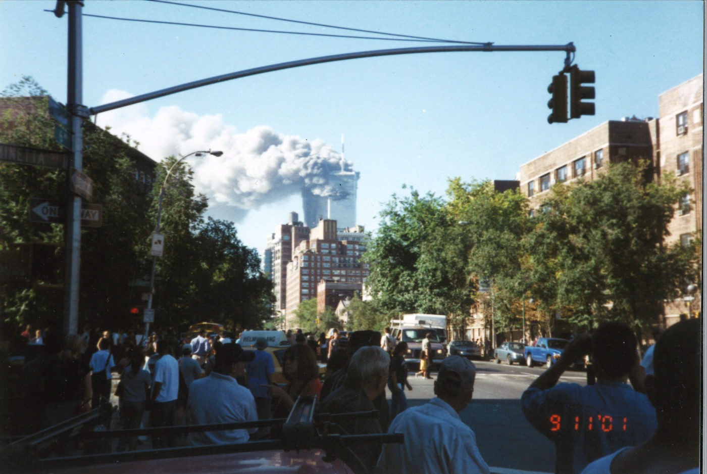 New Yorkers Standing watching the Towers Burning from the Corner of 6th Avenue and Minetta Street .jpg