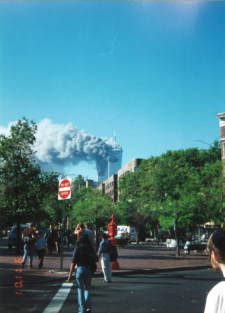 New Yorkers Watching and Some Walking Away as the Towers are on Fire Looking South From Father Demo Square.jpg