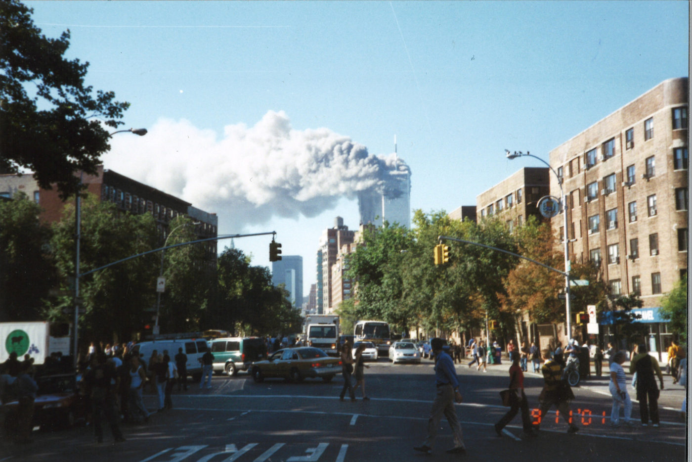 New Yorkers Watching the Towers Burning as they Cross 6th Avenue .jpg