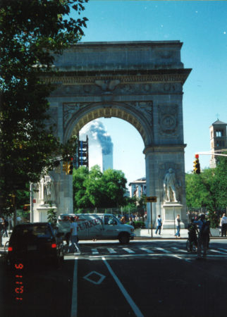 Tower 1 Burning after Collapse of Tower 2 through the Arch.jpg