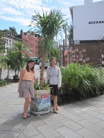 GVSHP Staffers Dana and Elizabeth stand in front of mosaic planter donated by Jim Powers 09_07_2011 002.JPG