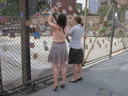 Village Preservation Staffers Dana Schultz and Elizabeth Finklestein re-installing 9-11 Tiles on 9.8.2011.JPG