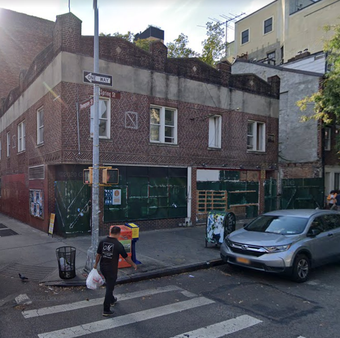 182 Spring Street circa 2019, a two story brick building that is vacant