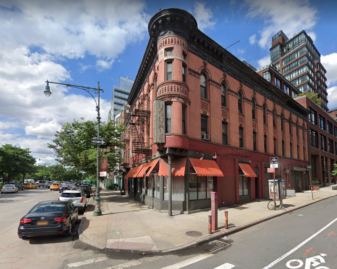 396 West Street from Google Maps circa 2019, 3 story corner building with masonry facade