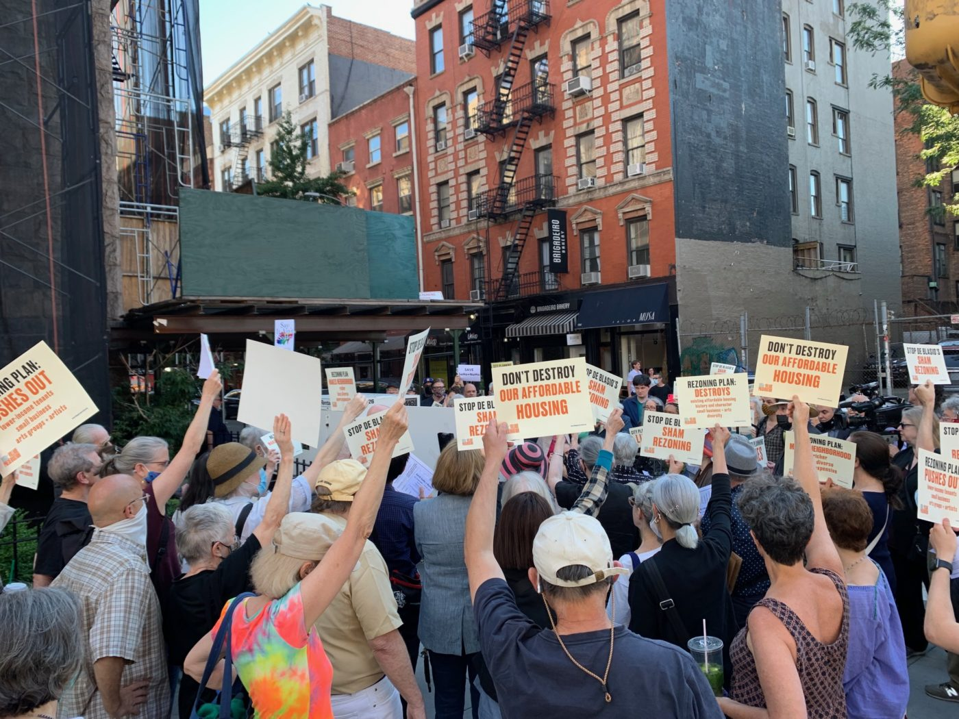 Crowd holdings signs at press conference/rally prior to hearing on SoHo/NoHo/Chinatown upzoning, June 23, 2021