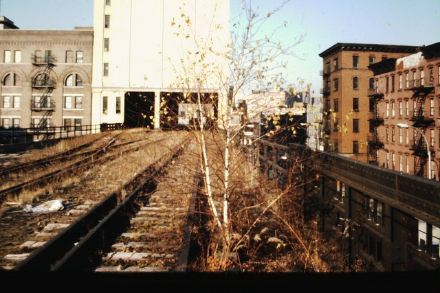 High Line looking north from Jane Street as it goes through former Manhattan Refrigeration Co. Building (now West Coast Apartments) at Horatio St..jpg